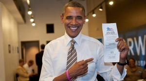 The President holds up his early voting receipt