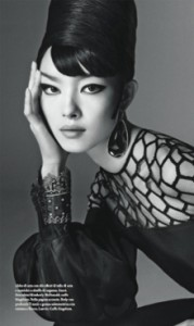Fei Fei Sun wearing a elaborate top, with honeycomb cutouts across her upper torso and a huge pouf sleeve.